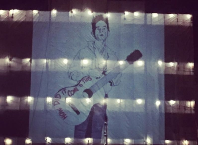 Woody Guthrie Art Projection on Oklahoma Capitol Sparks #WoodysGuitar Protest Movement