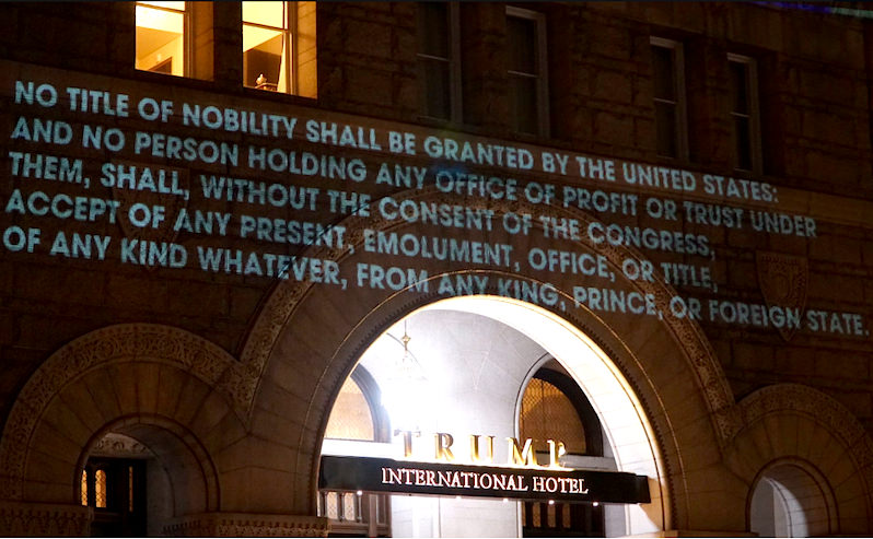 Artist Projects Emoluments Clause Onto Trump Hotel in Washington, D.C.
