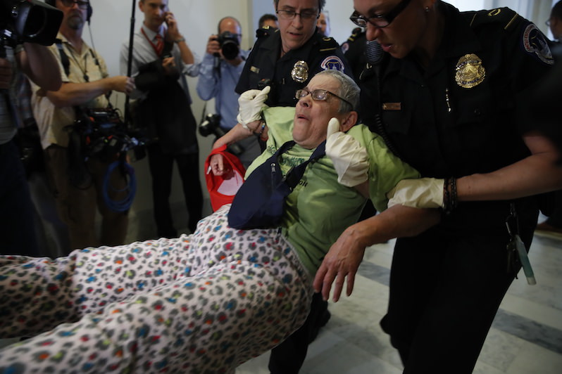Disabled Activists Put Their Bodies on the Line to Defend Health Care