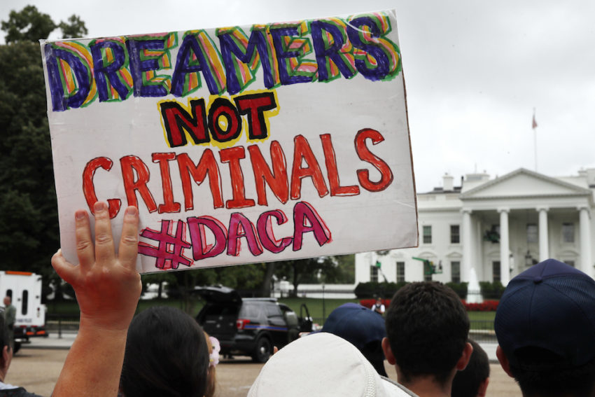 Trump urged not to scrap DACA policy for young immigrants
