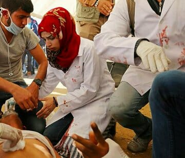 Israeli Forces Kill Palestinian Nurse, Injure 100 Protesters