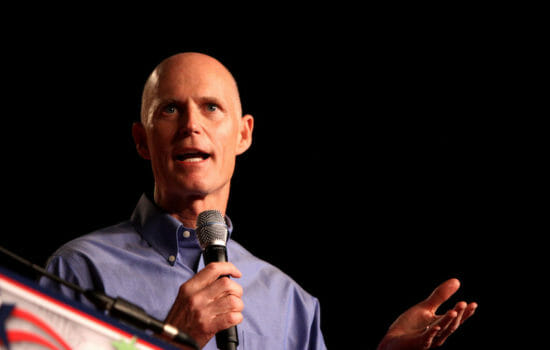 Florida Governor Flees Booing Environmentalists at Campaign Event