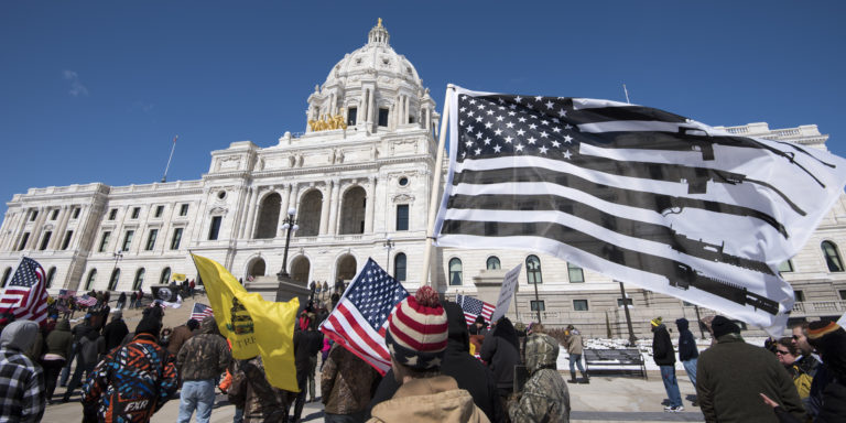 It's a grand old flag: Opponents of gun control, rallying at the Minnesota Capitol in St. Paul in 2018, fly their own version of the U.S. flag. (Fibonacci Blue / Flickr)