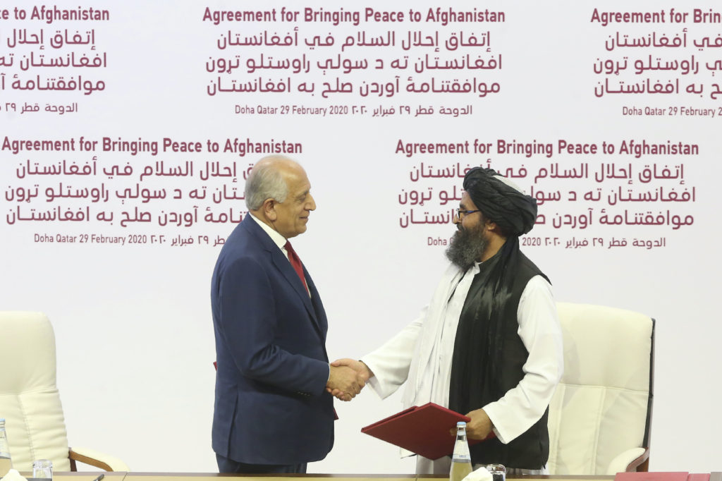Taliban and U.S. officials shake hands over Afghan peace deal